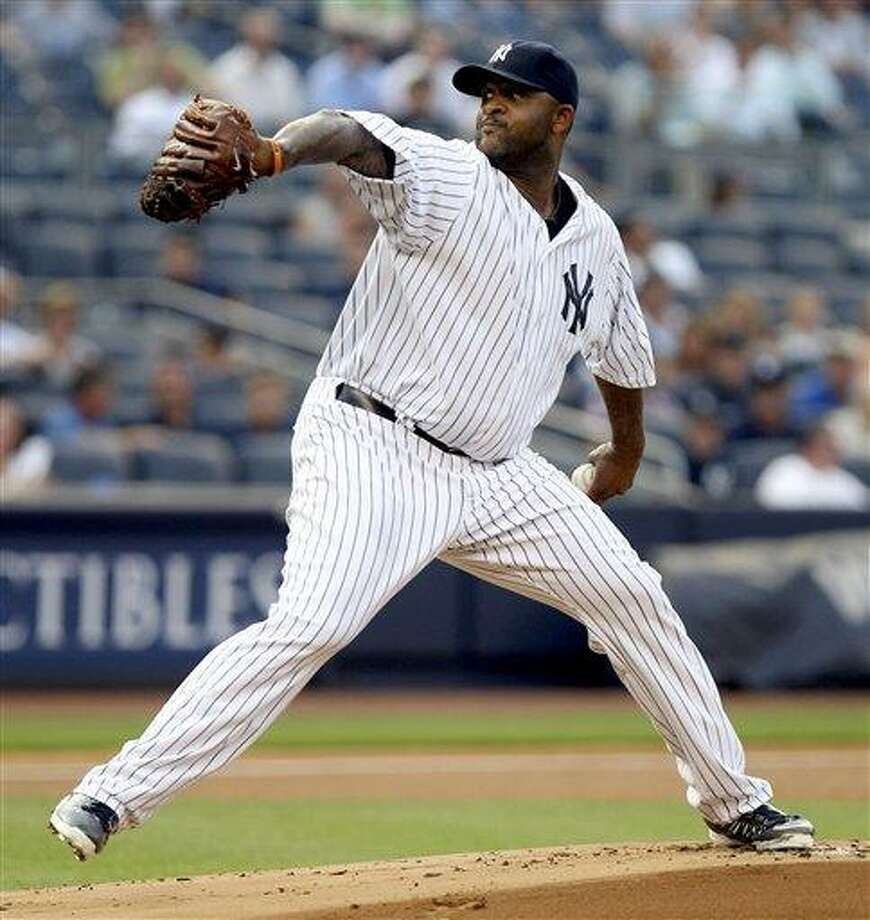 New York Yankees starting pitcher CC Sabathia delivers during the first inning of a baseball game against the Toronto Blue Jays, Tuesday, July 17, 2012, at Yankee Stadium in New York. (AP Photo/Seth Wenig) Photo: AP / AP