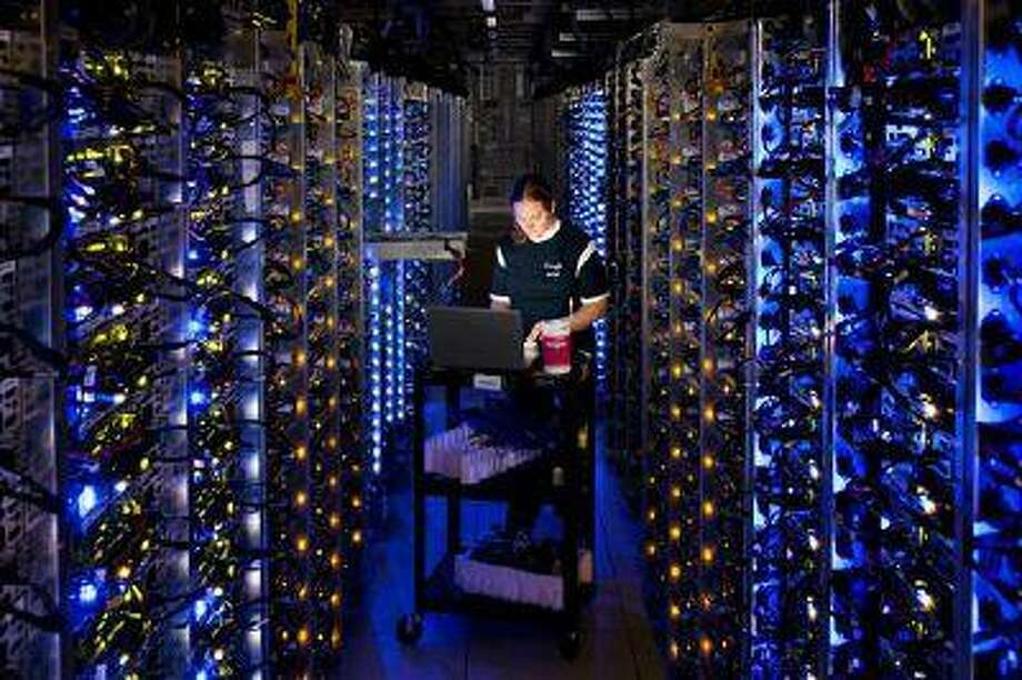 In this undated photo made available by Google, Denise Harwood diagnoses an overheated computer processor at Google's data center in The Dalles, Ore. Google uses these data centers to store email, photos, video, calendar entries and other information shared by its users. These centers also process the hundreds of millions of searches that Internet users make on Google each day. (AP Photo/Google, Connie Zhou) Photo: AP / Google