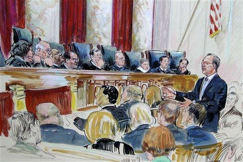 This artist rendering shows Paul Clement speaking in front of the Supreme Court in Washington Tuesday as the court continued hearing arguments on the health care law signed by President Barack Obama. Justices, seated from left, are Sonia Sotomayor, Stephen Breyer, Clarence Thomas, Antonin Scalia, Chief Justice John Roberts, Anthony Kennedy, Ruth Bader Ginsburg Samuel Alito and Elana Kagan.  Associated Press Photo: AP / AP