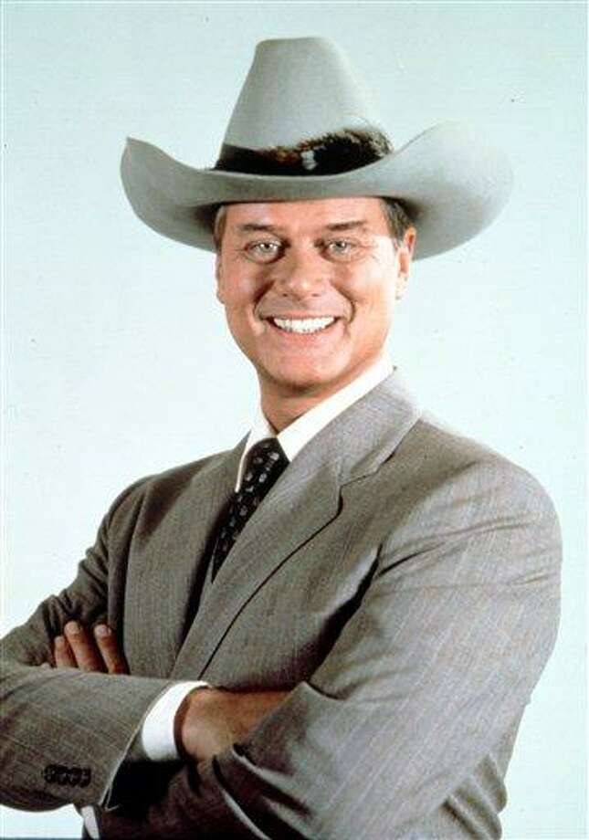 "This 1981 file photo provided by CBS shows Larry Hagman in character as J.R. Ewing in the television series ""Dallas."" Actor Larry Hagman, who for more than a decade played villainous patriarch JR Ewing in the TV soap Dallas, has died at the age of 81, his family said Saturday Nov. 24, 2012. (AP Photo/CBS, file) Photo: AP / CBS"