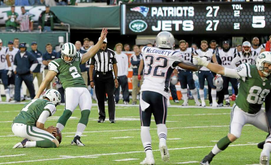 New York Jets kicker Nick Folk (2) kicks a field goal to win the game during overtime of an NFL football game against the New England Patriots Sunday, Oct. 20, 2013 in East Rutherford, N.J. The Jets won the game 30-27. The Patriots' Devin McCourty (32) is at center. (AP Photo/Seth Wenig) Photo: AP / AP