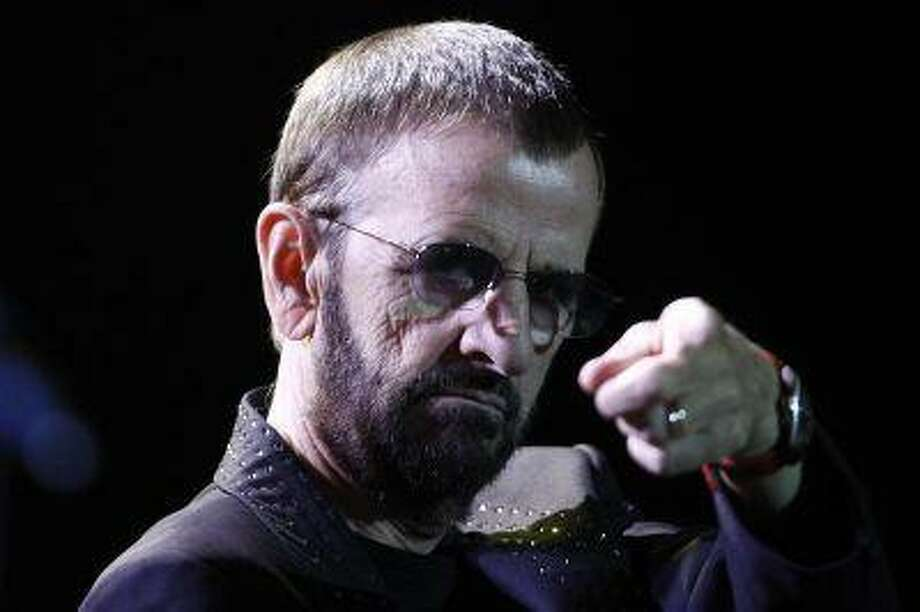 Musician Ringo Starr performs during his concert at the Ulysses Guimaraes Convention Center in Brasilia November 18, 2011. REUTERS/Ueslei Marcelino / X02828