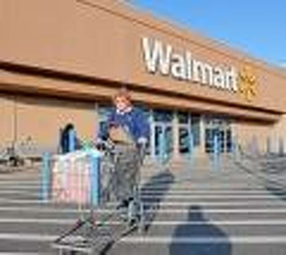 Branford--Vivian Baker heads out of the Branford Walmart. Walmart opens tomorrow for the holiday shopping season. Baker is from Branford. Photo (right) Peter Casolino/New Haven Register 11/21/12