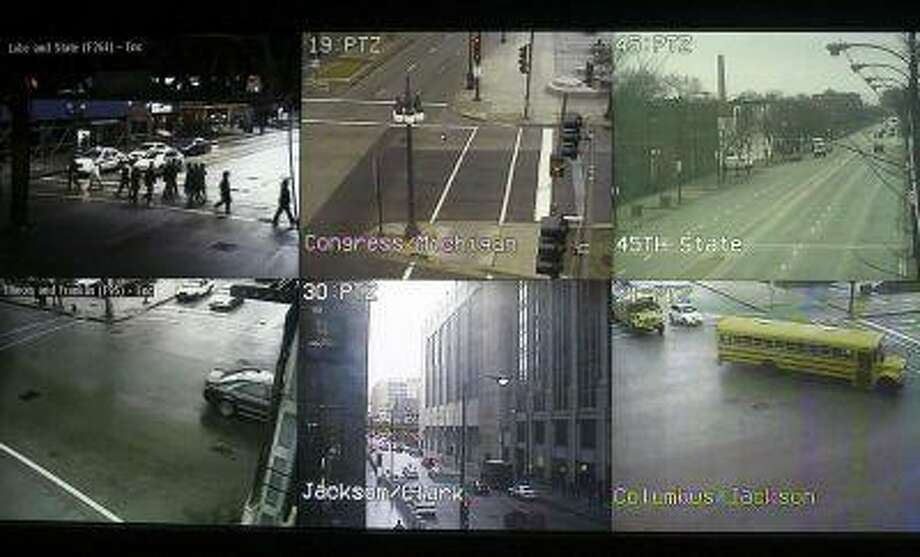 Screens displaying views from cameras located on the streets of Chicago are seen at the Chicago Emergency Communication Center, January 12, 2007. (Joshua Lott/Reuters) / X01971
