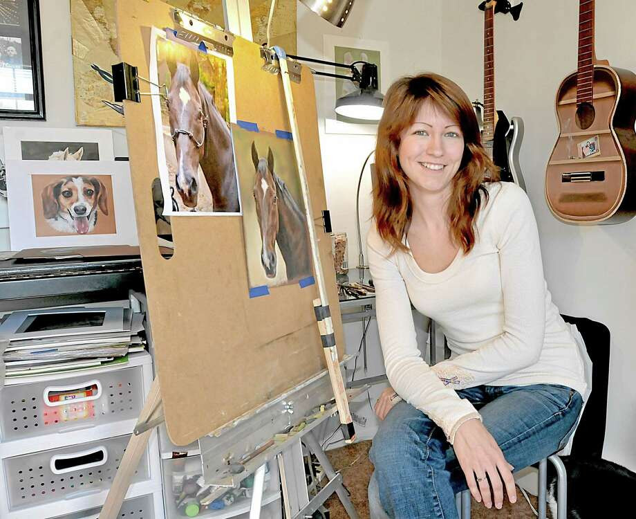 Middletown pet portrait artist,  Jenna Wilke, 24, in her home studio. Photo: Catherine Avalone - The Middletown Press   / TheMiddletownPress