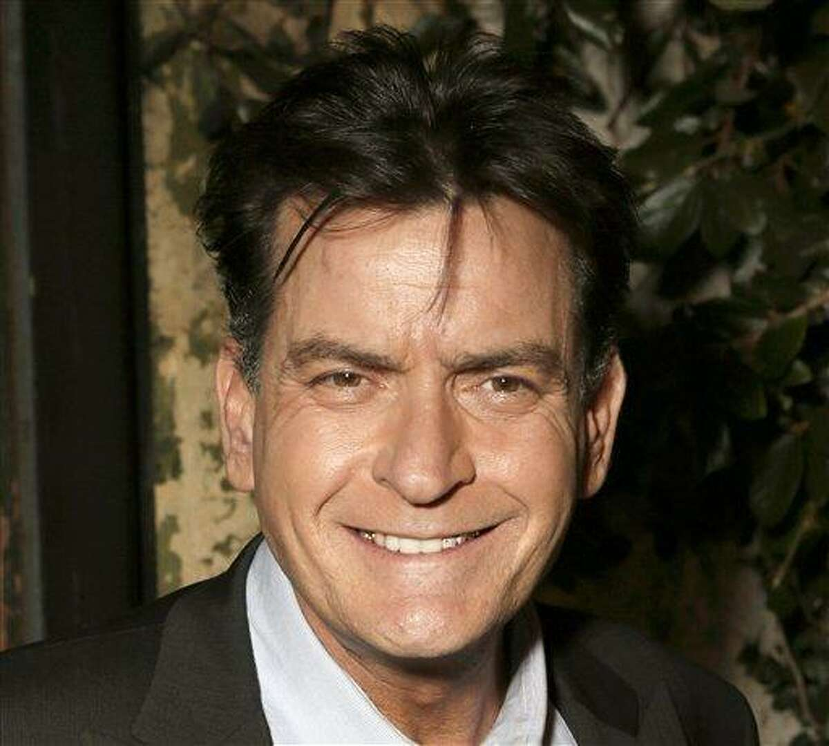 Charlie Sheen has pledged at least $1 million to the USO. Associated Press