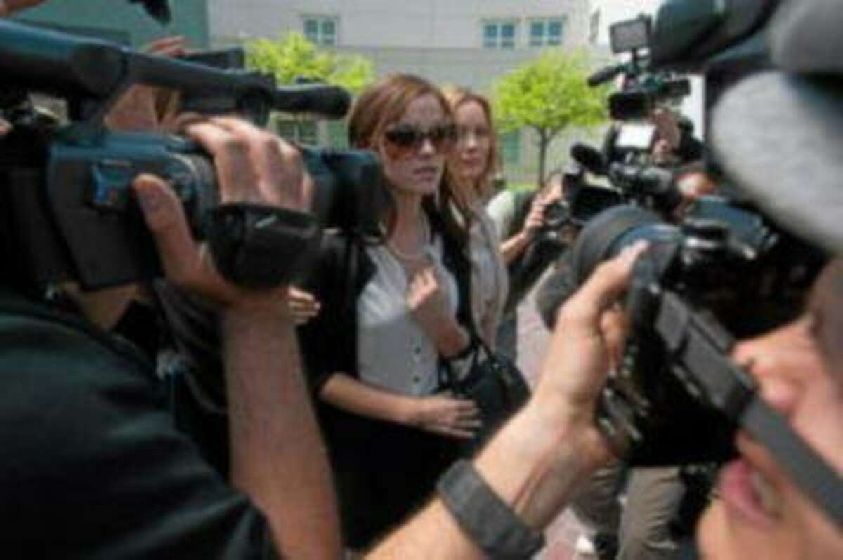"""Emma Watson and Leslie Mann face the paparazzi before a court date in """"The Bling Ring."""""""