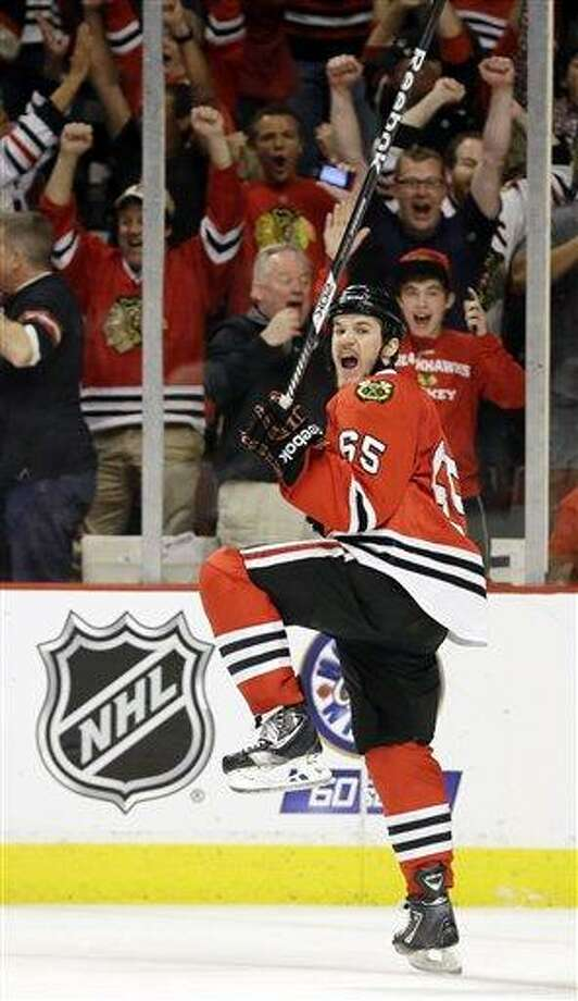 Chicago Blackhawks center Andrew Shaw (65) celebrates after scoring the winning goal during the third overtime period of Game 1 in their NHL Stanley Cup Final hockey series against the Boston Bruins, Thursday, June 13, 2013, in Chicago. (AP Photo/Nam Y. Huh) Photo: AP / AP