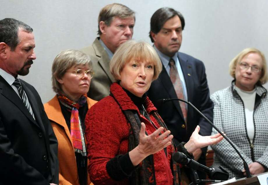 Supporters of compassionate aid-in-dying legislation, including left to right: Dr. Gary Blick of Norwalk, State Rep. Susan Johnson, D-49,  State Sen. Edward Meyer, D-12, Compassion & Choices (Portland, OR) president  Barbara Coombs Lee, State Rep. Philip Miller, D-36, and State. Sen. Terry Gerratana, D-6, at a press conference at the Legislative Office Building. Mara Lavitt/New Haven Register2/5/13