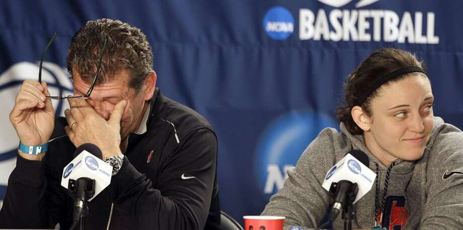 Connecticut head coach Geno Auriemma rubs his eyes and Connecticut guard Kelly Faris looks on while a teammate speaks during an NCAA college basketball news conference in Kingston, R.I., Monday, March 26, 2012. Connecticut is scheduled to play Kentucky in a women's NCAA tournament East Regional final college basketball game on Tuesday in Kingston. (AP Photo/Stephan Savoia) Photo: AP / AP