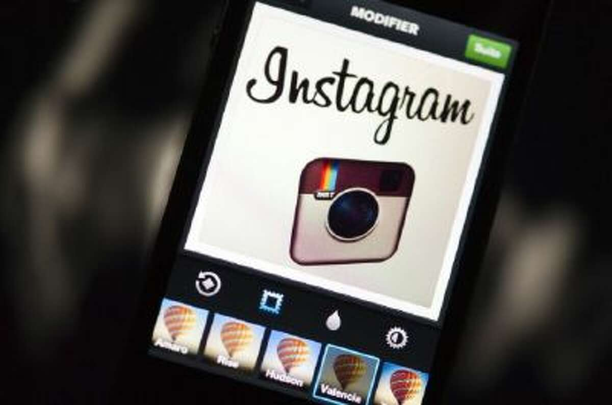The Instagram logo displayed on a smartphone. Windows Phone users are finally getting their very own Instagram app.