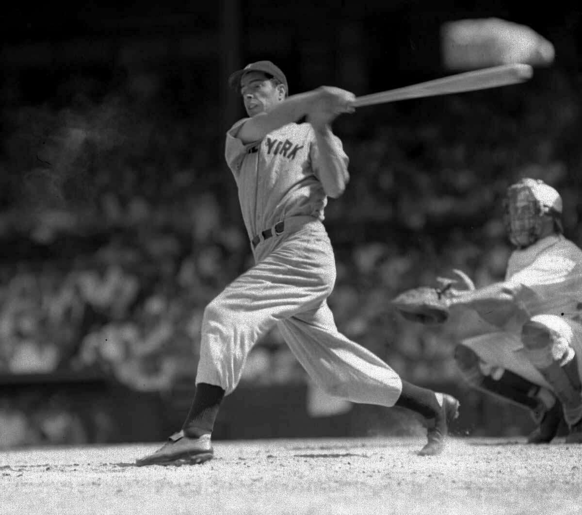 Joe DiMaggio lines a single to left field in the seventh inning of the second game of a doubleheader at Washington June 29, 1941, to set a record for hitting safely in 42 consecutive games. In the first game, DiMaggio tied George Sisler's record of 41 games, set in 1922. The catcher is Jake Early of the Washington Senators. Yankees won both games, 9-4, 7-5. (AP photo)