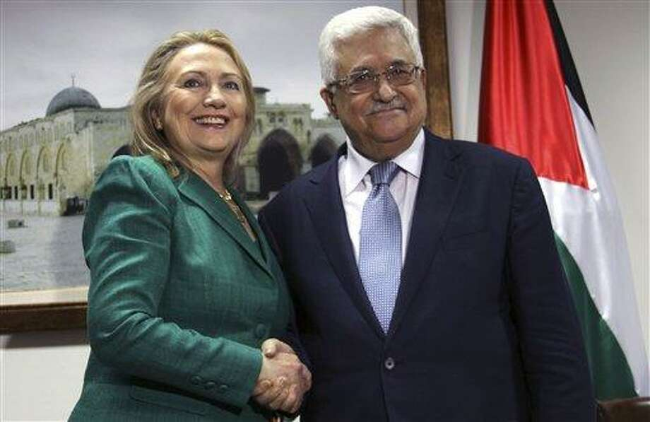 U.S. Secretary of State Hillary Rodham Clinton, left, shakes hands with Palestinian President Mahmoud Abbas during a meeting in the West Bank city of Ramallah, Wednesday, Nov. 21, 2012. Clinton will try on Wednesday to wring an elusive truce deal from Israel and Gaza's militant Hamas rulers after earlier efforts to end more than a week of fighting broke down amid a furious spasm of violence.(AP Photo/Alaa Badarneh, Pool) Photo: AP / Pool EPA