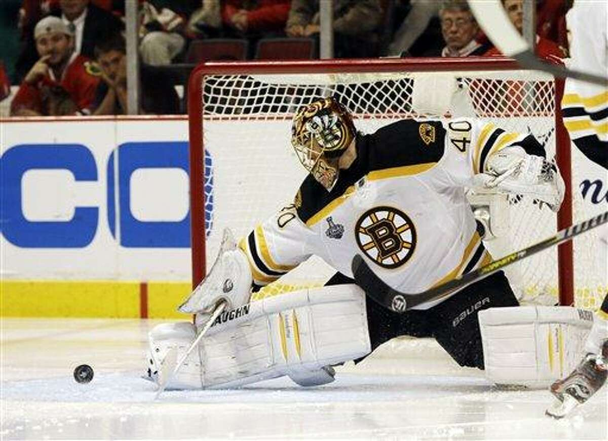 Boston Bruins goalie Tuukka Rask (40) blocks a shot by Chicago Blackhawks center Andrew Shaw (65) during the first overtime period of Game 1 in their NHL Stanley Cup Final hockey series, Wednesday, June 12, 2013, in Chicago. (AP Photo/Nam Y. Huh)