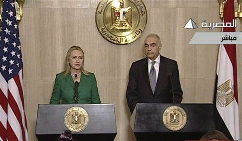 In this image made from Egyptian State Television, U.S. Secretary of State Hillary Rodham Clinton, left, and Egyptian Foreign Minister Mohammed Kamel Amr, right, give a joint news conference announcing a cease-fire between Israel and Hamas in Cairo, Egypt, Wednesday, Nov. 21, 2012. Egypt has announced a cease-fire agreement to end a week of fighting between Israel and Hamas militants in the Gaza Strip. Foreign Minister Mohammed Kamel Amr said the truce would take effect at 9 p.m. local time (2 p.m. EDT.) He made the announcement alongside visiting U.S. Secretary of State Hillary Rodham Clinton. (AP Photo/Egyptian State Television) Photo: AP / Egypt State TV