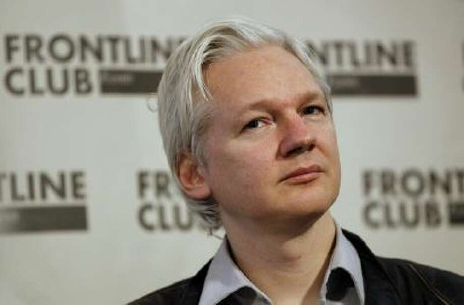 Julian Assange, founder of WikiLeaks listens at a press conference in London, Monday, Feb. 27, 2012.
