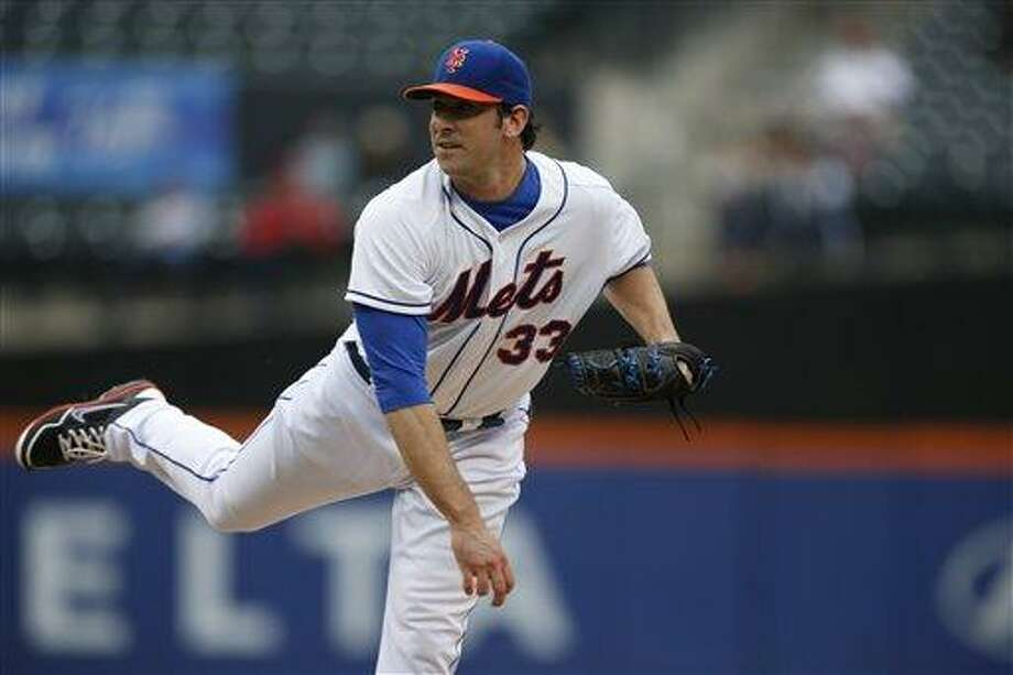 New York Mets starting pitcher Matt Harvey (33) follows through in the second inning in a baseball game in New York, Thursday, June 13, 2013. (AP Photo/Kathy Willens) Photo: AP / AP