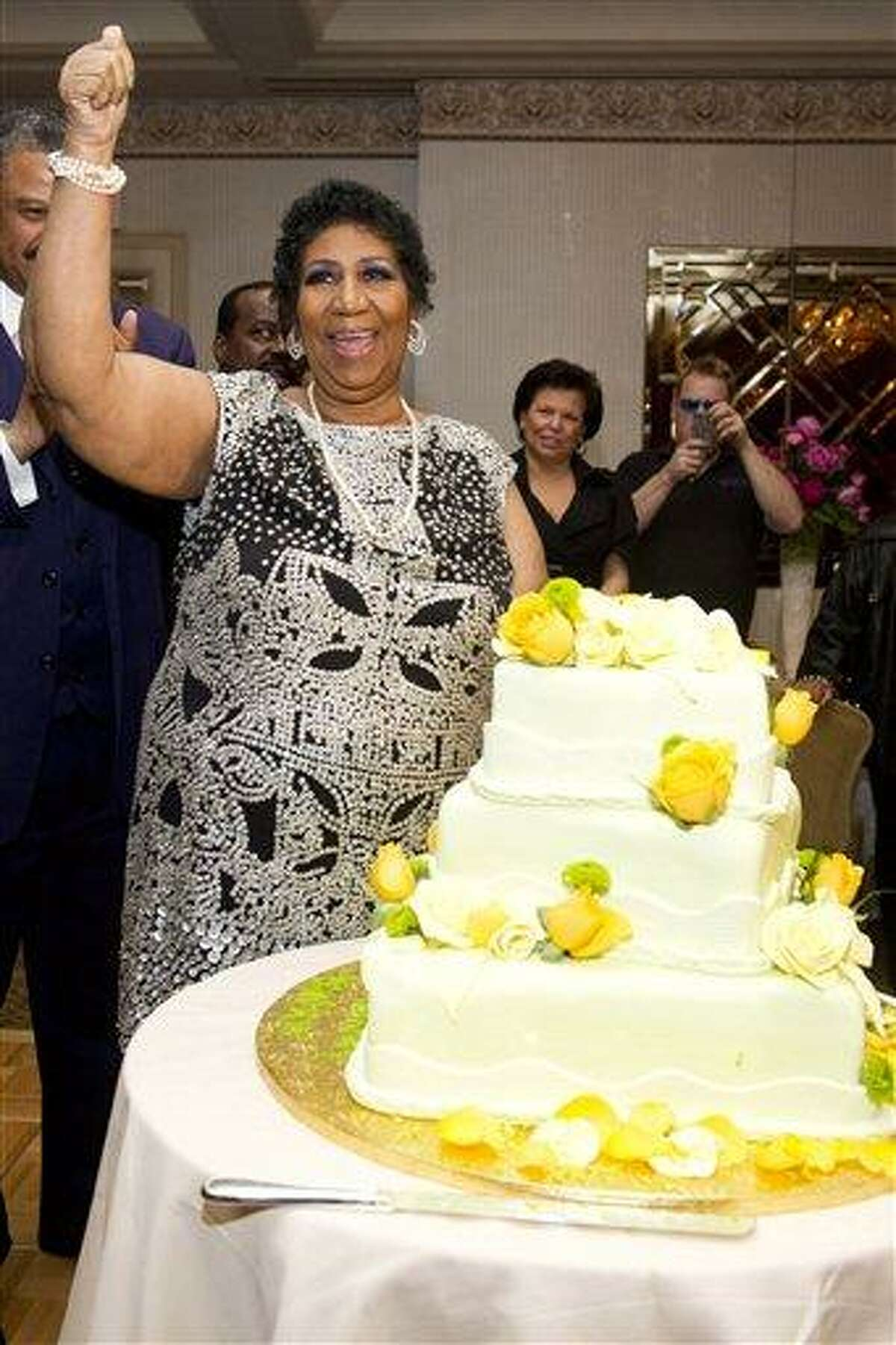 Aretha Franklin attends her 70th birthday party in New York, Saturday. Associated Press