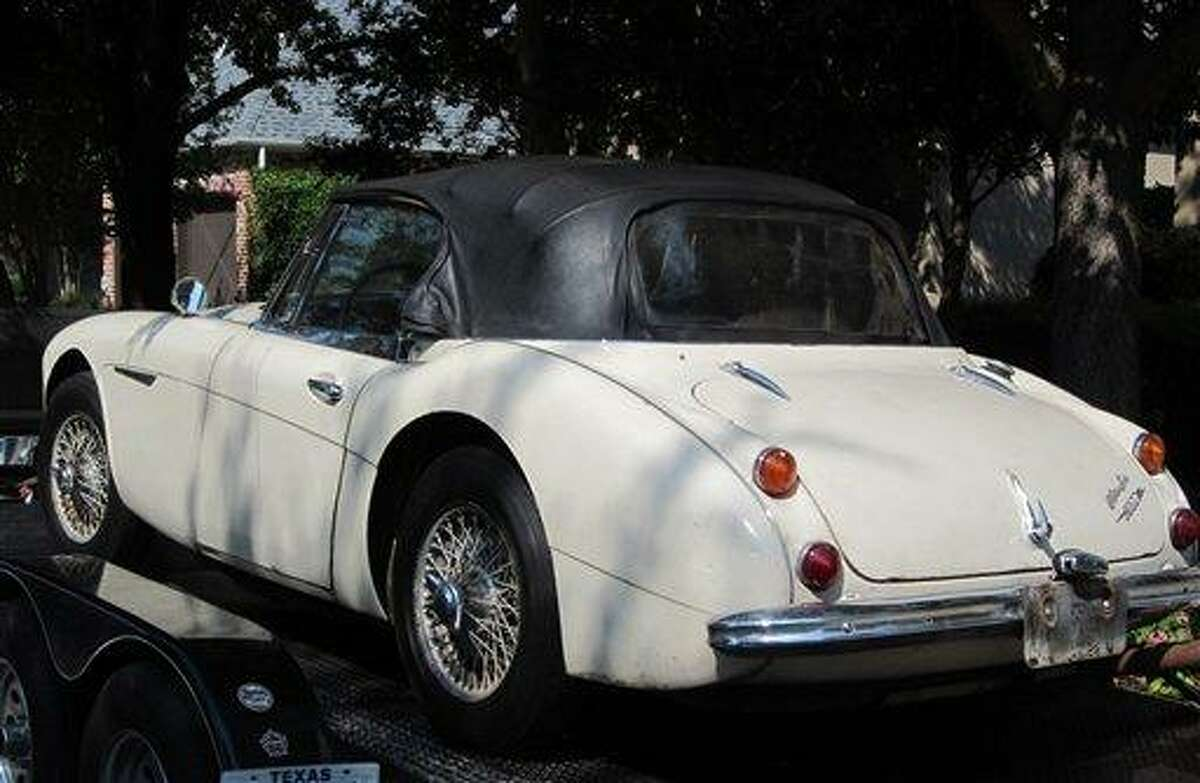 In this image provided by the Los Angeles County Sheriff's Department, the stolen car sits on a small transport trailer as it is delivered to Robert Russell's home in Texas. Russell whose prized 1967 Austin Healy sports car was stolen 42 years ago, recovered the vehicle after spotting it on eBay, authorities said Sunday July 15, 2012. Associated Press