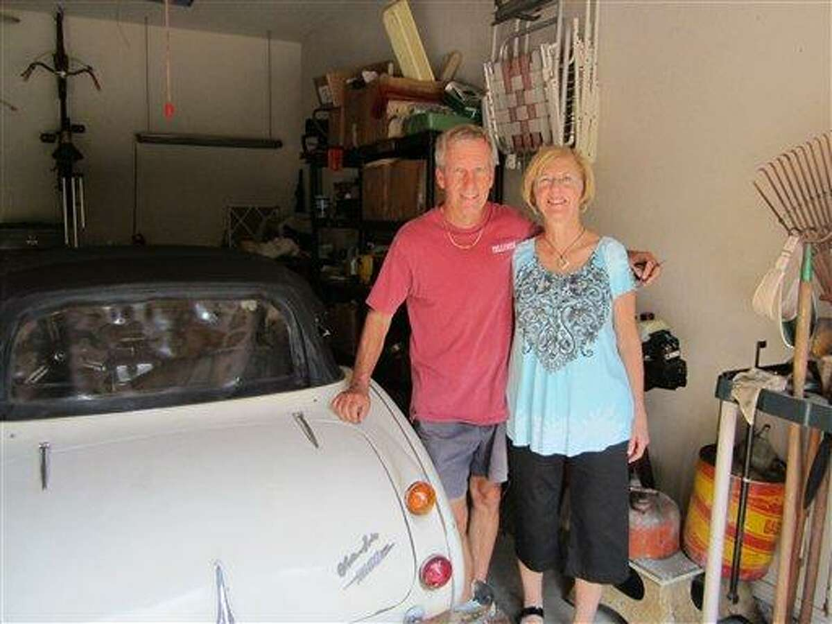 Russell and his wife stand next to the car in their Texas garage after it was delivered to their home in Texas. Associated Press