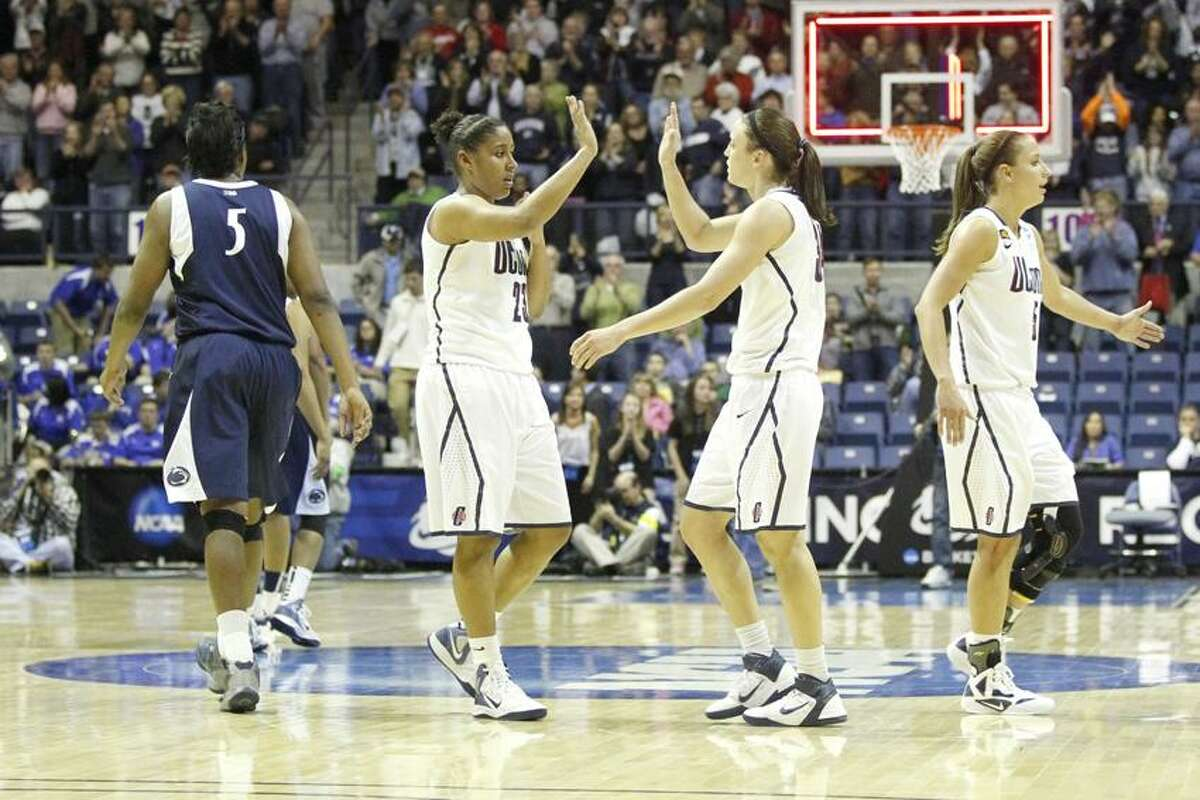 Mar 25, 2012; Kingston, RI, USA; `c23 and guard Kelly Faris (34) react after defeating the Penn State Lady Lions in the semifinals of the Rhode Island region in the 2012 NCAA women's basketball tournament at the Ryan Center. UConn defeated the Penn State Lady Lions 77-59. Mandatory Credit: David Butler II-US PRESSWIRE