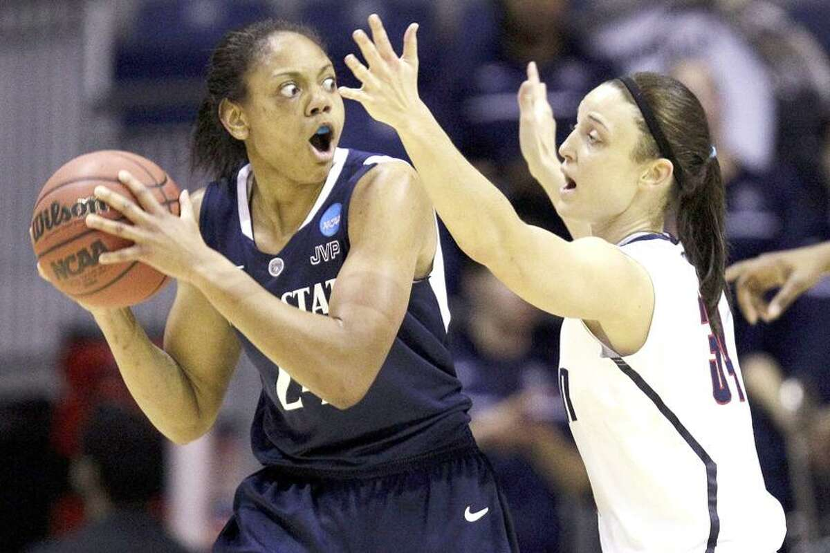 Penn State forward Mia Nickson (24) looks for an outlet around Connecticut guard Kelly Faris (34) during the first half of their NCAA women's tournament regional semifinal college basketball game in Kingstown, R.I., Sunday, March 25, 2012. (AP Photo/Stephan Savoia)