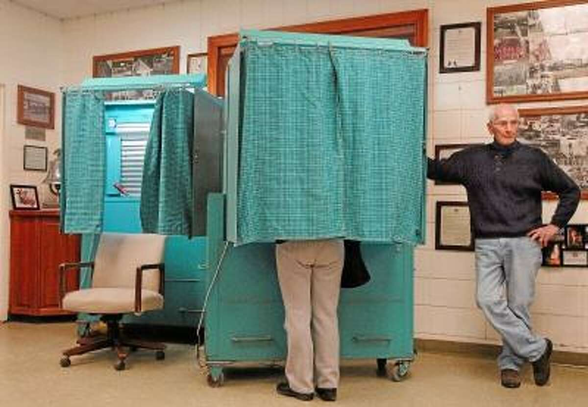 Catherine Avalone/The Middletown Press Residents living in the South Fire District voted Monday to elect a new commissioner for a term of five years beginning today at noon. Candidates David P. Gallitto, a resident of Kelsey Street and current chairman of the Board of Fire Commissioners defeated Todd Greatsinger, of Snipes Terrace. As of 6:15 p.m. 262 of the 7,600 residents voted.