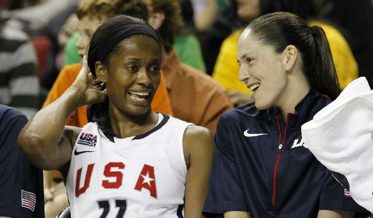 ASSOCIATED PRESS Former Seattle Storm teammates Swin Cash, left, and Sue Bird smile as they sit together on the bench in the final moments as the United States played China in an exhibition game on May 12 in Seattle. Cash, Bird and Asjha Jones are all on the USA Women's Basketball team as it competes for gold in the Summer Olympics in London.