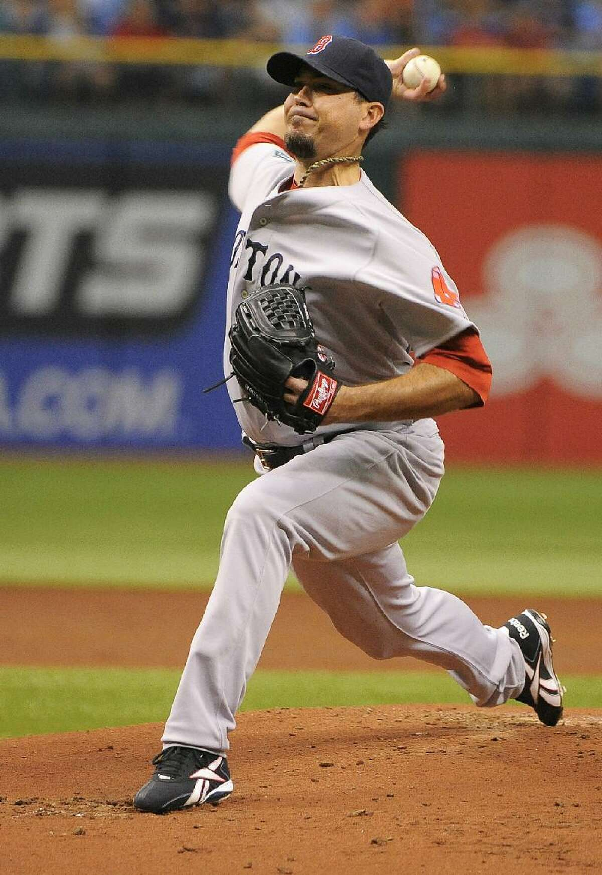 ASSOCIATED PRESS Boston Red Sox starting pitcher Josh Beckett delivers to the Tampa Bay Rays during the second inning of Sunday's game in St. Petersburg, Fla. The Red Sox won 7-3.