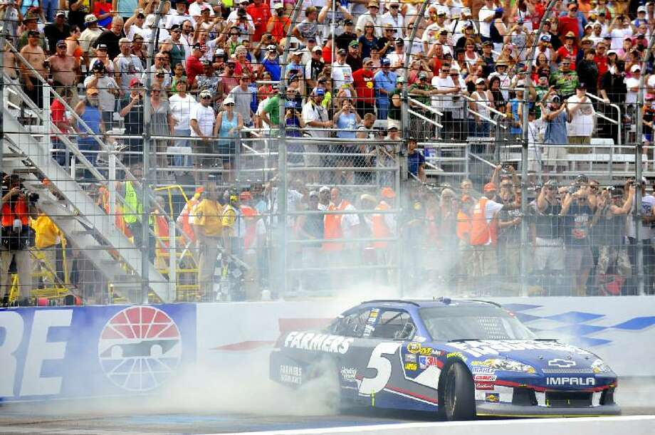 ASSOCIATED PRESS/AUTOSTOCK, NIGEL KINRADE Kasey Kahne celebrates with a burnout after winning the NASCAR Sprint Cup Series auto race at New Hampshire Motor Speedway on Sunday in Loudon, N.H.