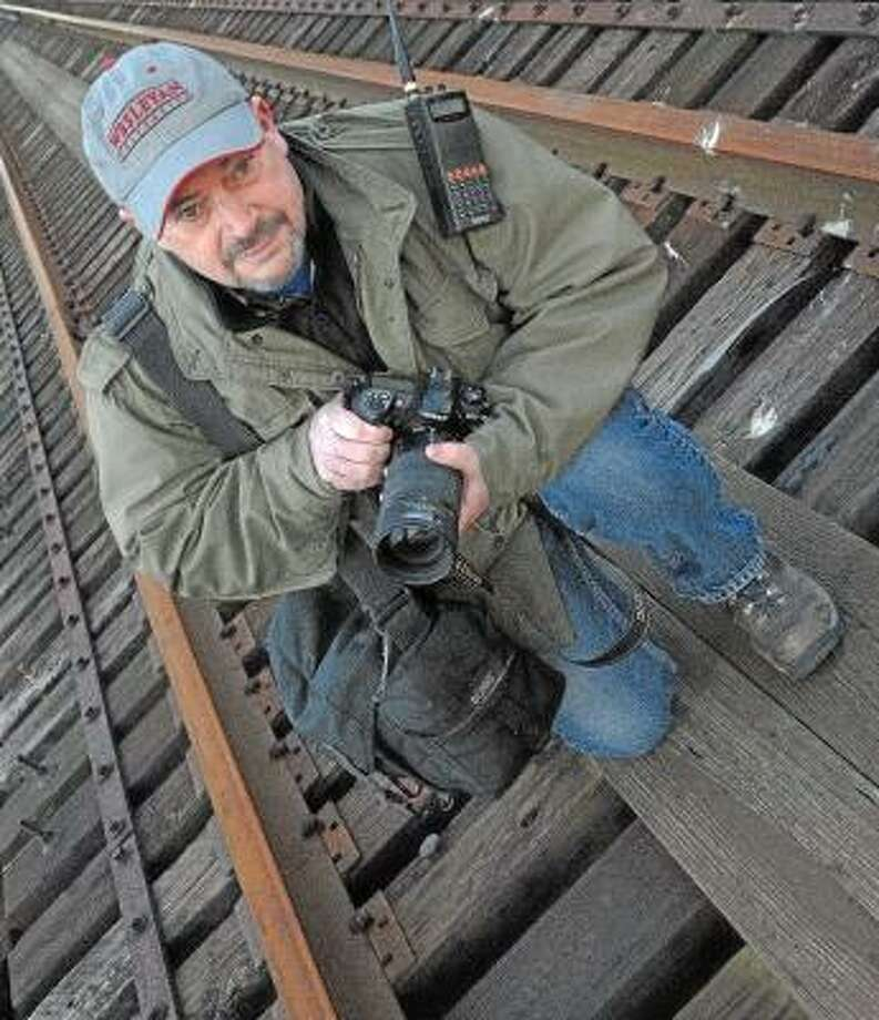 "Catherine Avalone/The Middletown Press Portland High School art teacher Stu Noelte has an photography exhibit entitled, ""Hot Shots: Trains Along Today's Water Level Route"" in the Mary Flood Room at the Portland Public Library for the month of February."