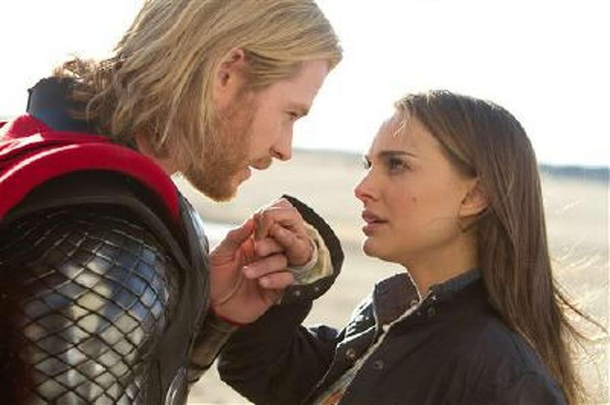 """In this film publicity image released by Paramount Pictures, Chris Hemsworth, portraying superhero Thor, and Natalie Portman, portraying jane Foster, are shown in a scene from the film, """"Thor."""""""