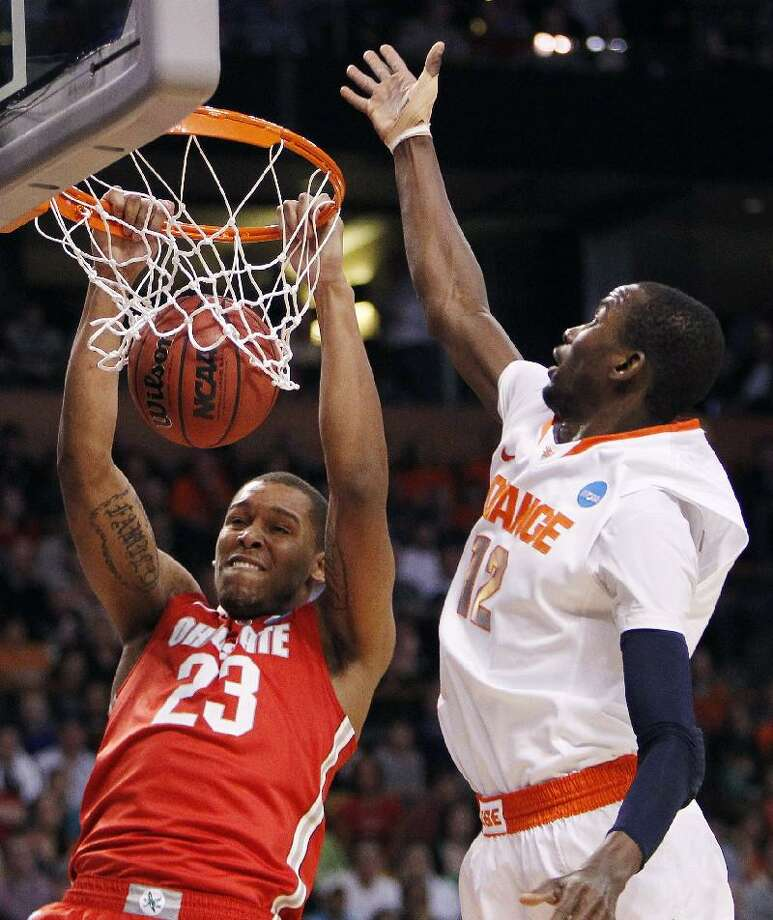 ASSOCIATED PRESS Ohio State center Amir Williams (23) dunks in front of Syracuse center Baye Keita (12) during the first half of the NCAA tournament East Regional final Saturday in Boston. The Buckeyes defeated the Orange 77-70 to advance to the Final Four in New Orleans.