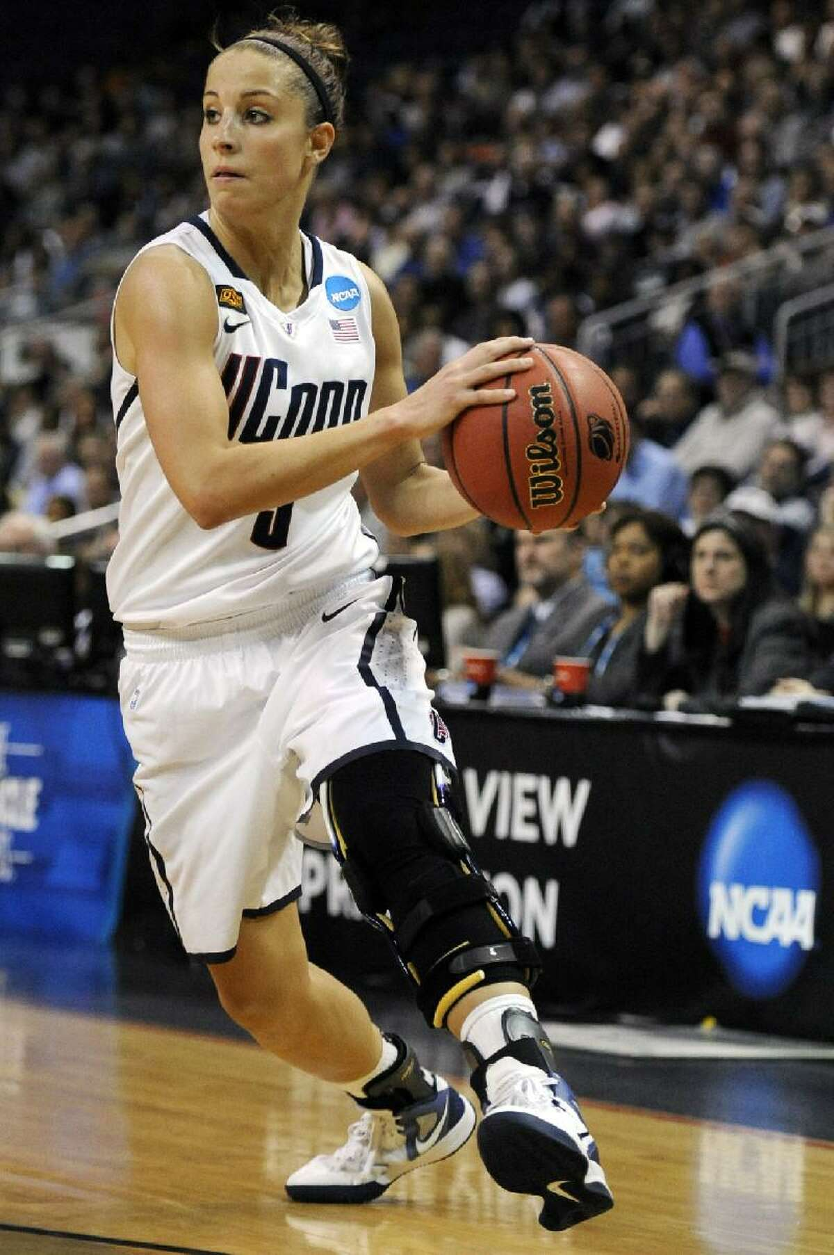 ASSOCIATED PRESS Connecticut's Caroline Doty looks to pass during the first half of an NCAA tournament second-round game against Kansas State in Bridgeport on March 19. Doty will have a reunion of sorts when she faces former teammate Maggie Lucas and Penn State in a Kingston Regional semifinal on Sunday.