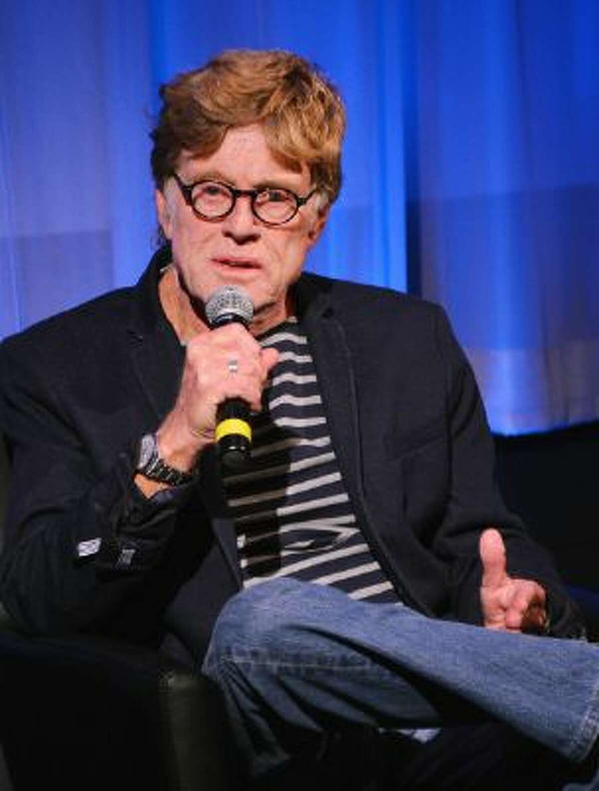 Robert Redford speaks to the audience at an official Academy members screening of