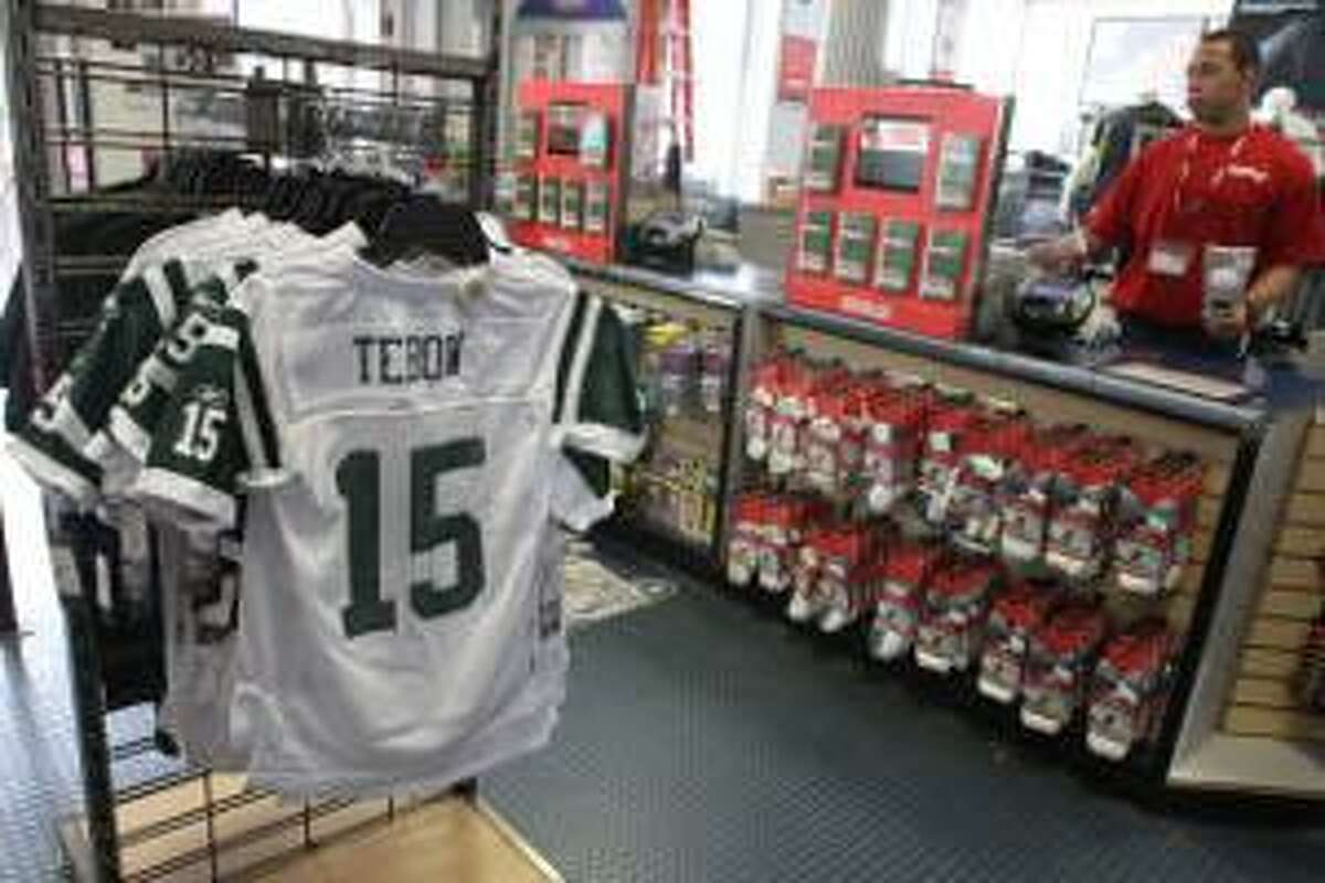 ASSOCIATED PRESS New York Jets football jerseys with the name and number of their new quartback Tim Tebow are on display at a Modell's store, Friday in New York. Tebow was traded Wednesday to the Jets from the Denver Broncos.