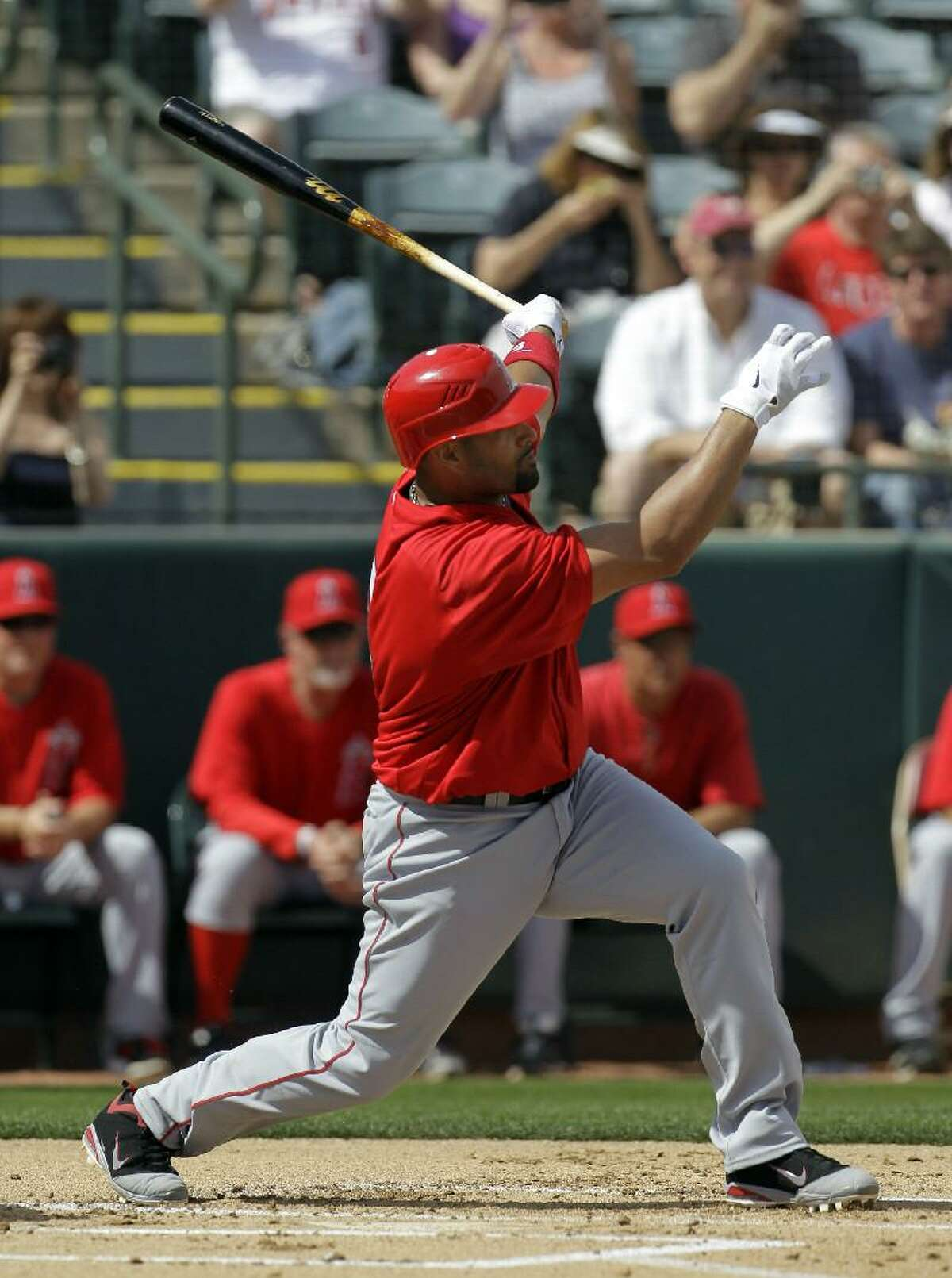 ASSOCIATED PRESS In this March 5 file photo, Los Angeles Angels first baseman Albert Pujols is shown at bat during a spring training game against the Oakland Athletics in Phoenix. Expect an extra wild year in baseball.