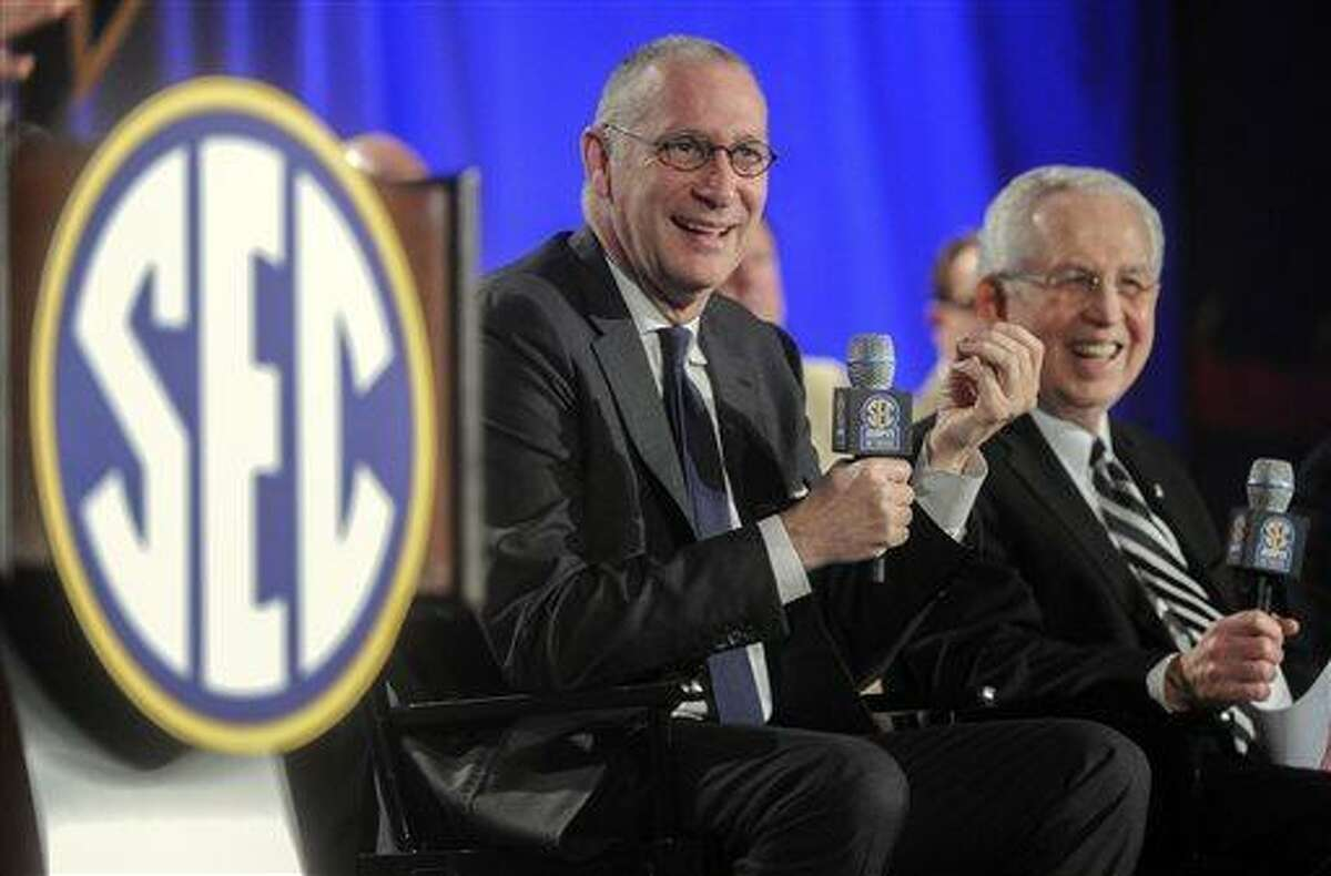 FILE - In this May 2, 2013 file photo, ESPN President John Skipper, left, and Southeastern Conference Commissioner Mike Slive address the media during a news conference announcing the launching of the SEC Network in partnership with ESPN, in Atlanta. (AP Photo/John Amis, File)