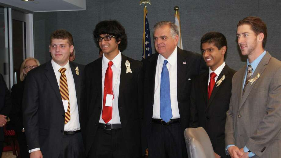 Submitted photo Left to right: Chris Muckle (Xavier High School '12), Miraj Rahematpura (Xavier High School '12), Ray LaHood (U.S. Secretary of Transportation), Mario Chris (Xavier High School '13), Michael Humphreys (Faculty, Xavier High School; Class of 2004)