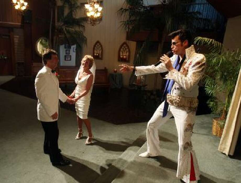 Brian Mills, right, an Elvis impersonator, marries Richard Johnson and Cheryl Bell of Peoria, Ariz. in Las Vegas. Their unusual wedding date was 9/9/09.