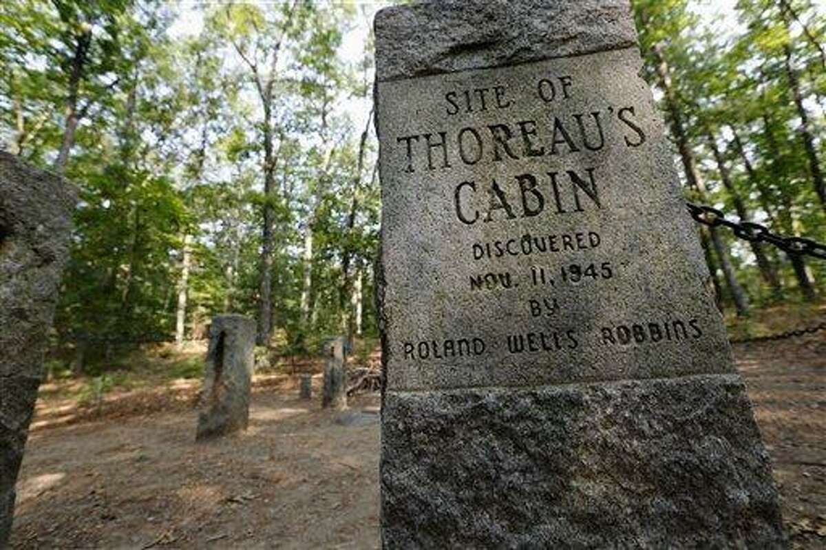 In this photo taken Friday, July 13, 2012, stone pillars delineate the actual site of Henry David Throeau's cabin on the shores of Walden Pond in Concord, Mass. (AP Photo/Michael Dwyer)