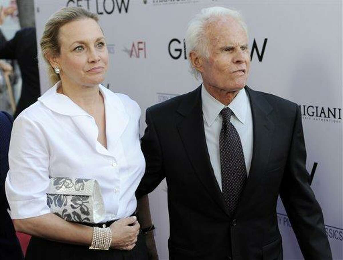 """FILE - In this July 27, 2010 file photo, producer, Richard Zanuck, and his wife Lili Fini Zanuck arrive at the premiere of the film """"Get Low"""" in Beverly Hills, Calif. According to his publicist, Richard D. Zanuck has died at age 77 in Los Angeles on Friday, July 13, 2012. He won an Oscar for best picture for his film, """"Driving Miss Daisy."""" (AP Photo/Chris Pizzello, File)"""