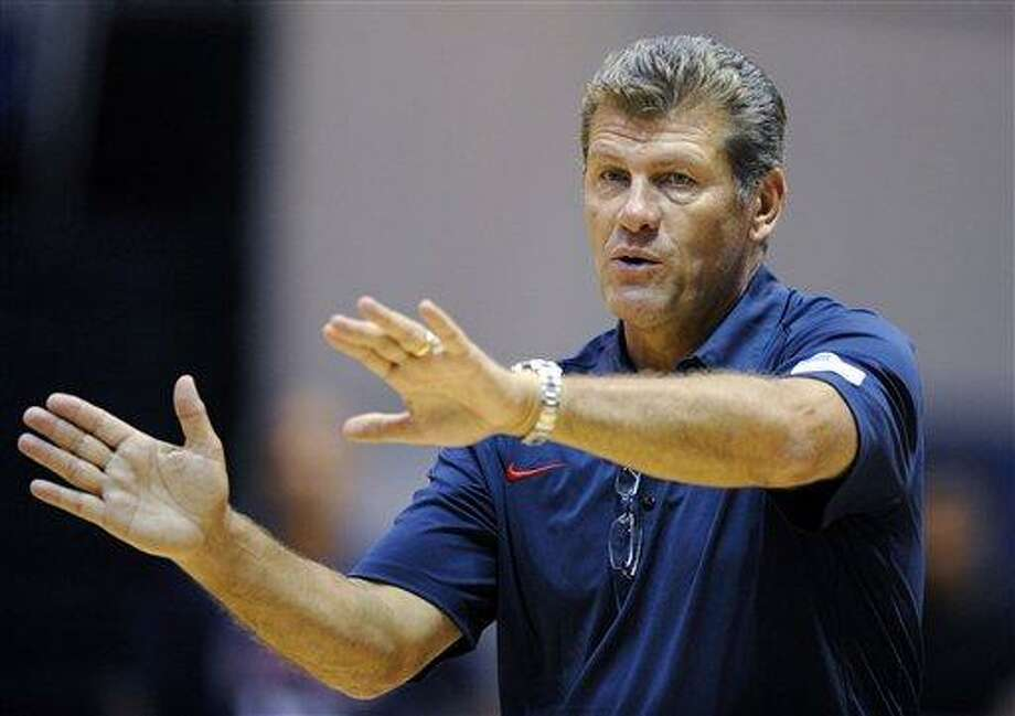 U.S. women's Olympic basketball coach Geno Auriemma gestures during practice, Saturday, July 14, 2012, in Washington. (AP Photo/Nick Wass) Photo: AP / FR67404 AP