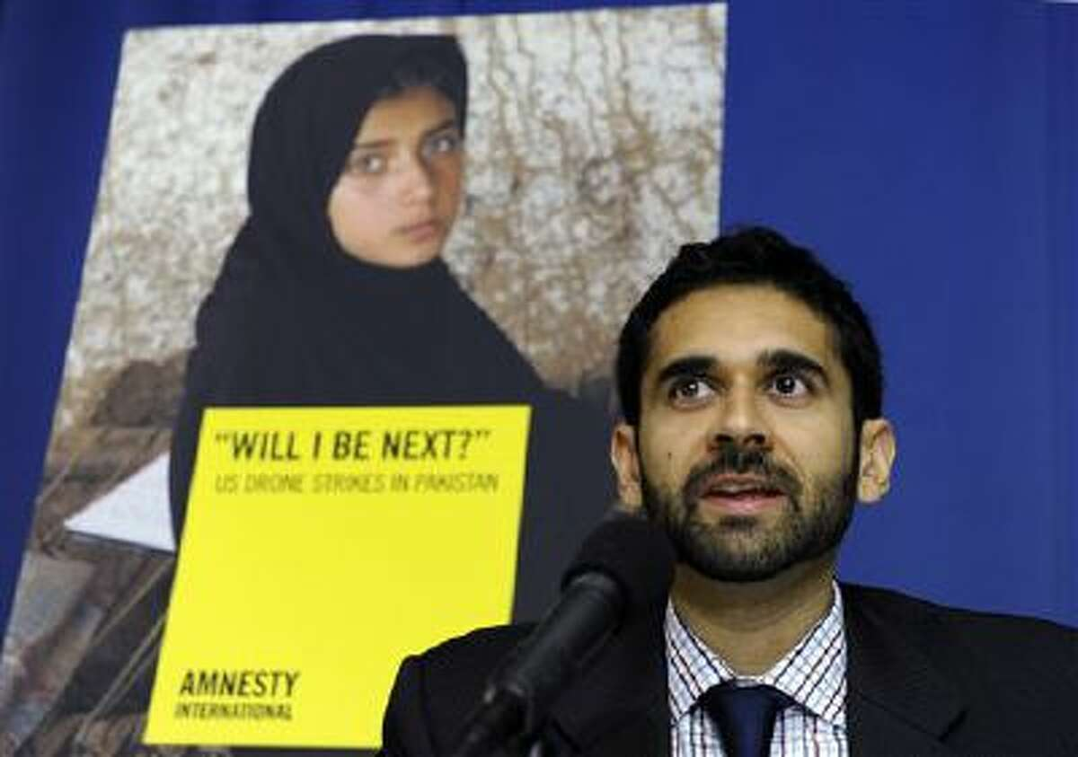 Mustafa Qadri, a Pakistan researcher at Amnesty International, talks about the findings of two new reports, by Amnesty International and Human Rights Watch, on US drone strikes and other air strikes in Pakistan and Yemen. (AP Photo/Susan Walsh)