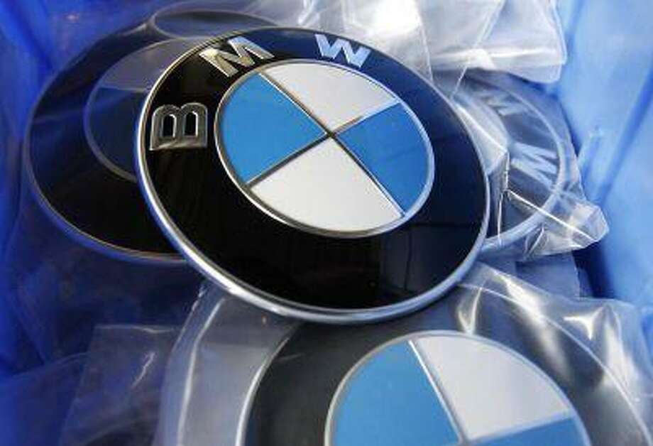 BMW luxury car logo's are pictured in a spare part store at a BMW garage in Niderwangen near Bern, May 24, 2012. (REUTERS/Pascal Lauener) / X90074