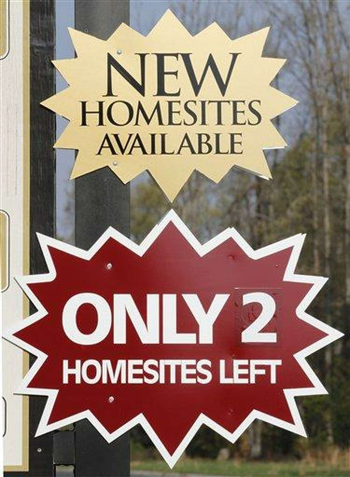 Signs promote new home sales in Mechanicsville, Va., Friday. Sales of U.S. new homes fell in February for the second straight month, a reminder that the depressed housing market remains weak despite some improvement. Associated Press