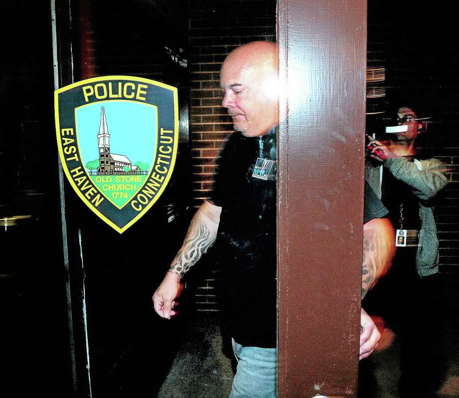 Angelo Appi Jr., responding to an arrest warrant, walks into the East Haven Police Department Tuesday. Photo: Arnold Gold — New Haven Register