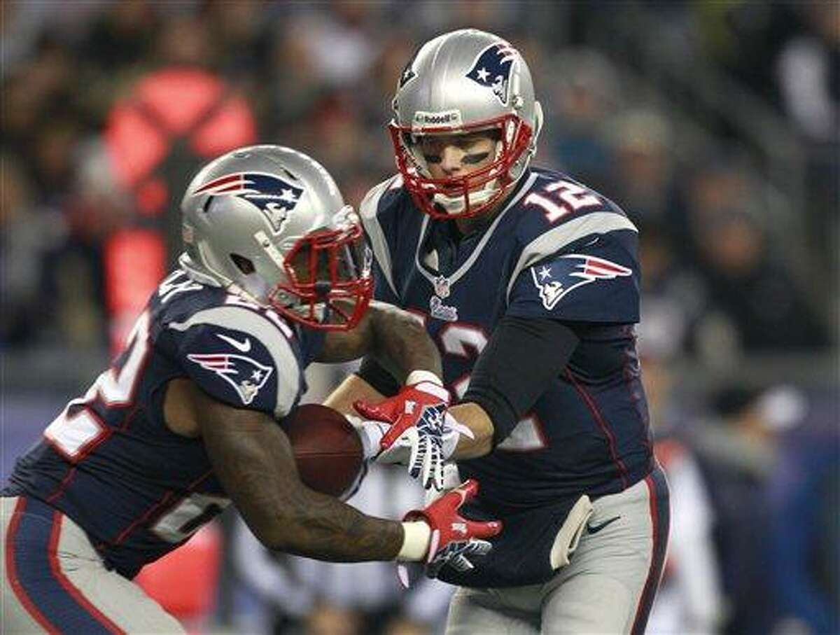 New England Patriots quarterback Tom Brady (12), right, hands off to Patriots running back Stevan Ridley (22), left, in the first quarter of an NFL football game against the Indianapolis Colts at Gillette Stadium, in Foxborough, Mass., Sunday, Nov. 18, 2012. (AP Photo/Steven Senne)