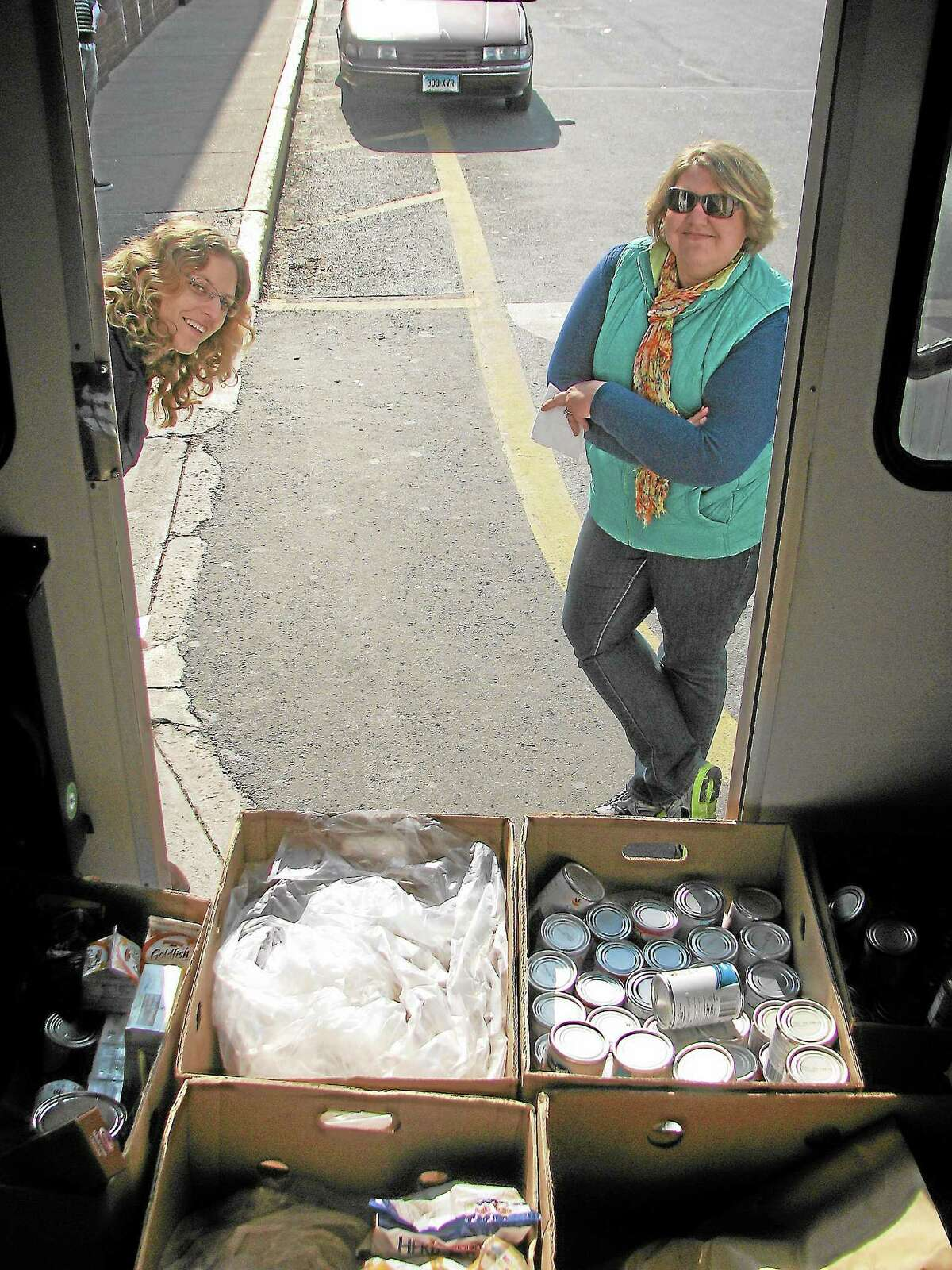 Submitted photoVolunteers collect food at last year's Fill-a-Bus event at Stop & Shop. Nonperishable food donations for the Middletown Community Thanksgiving Project will be collected Saturday, Oct. 26, at Stop & Shop in Middletown.
