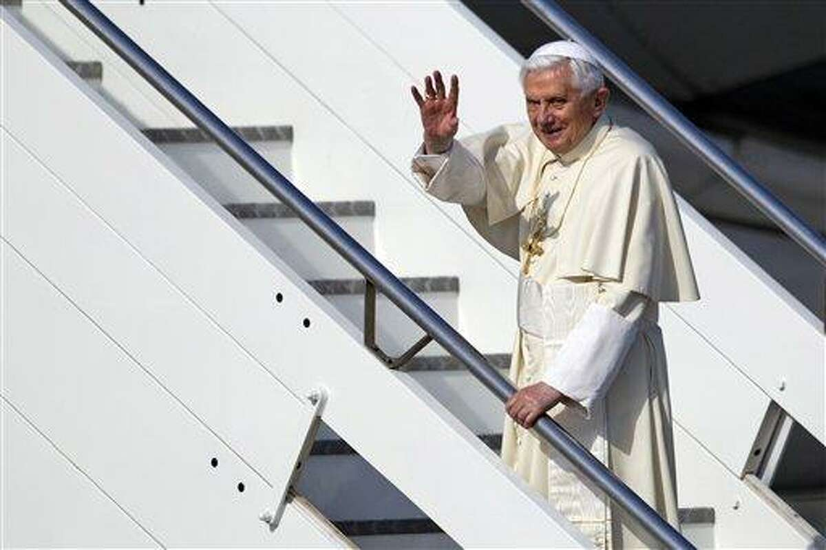 Pope Benedict XVI waves as he boards a plane on his way to a six-day visit to Mexico and Cuba at Rome's Fiumicino international airport Friday. Associated Press